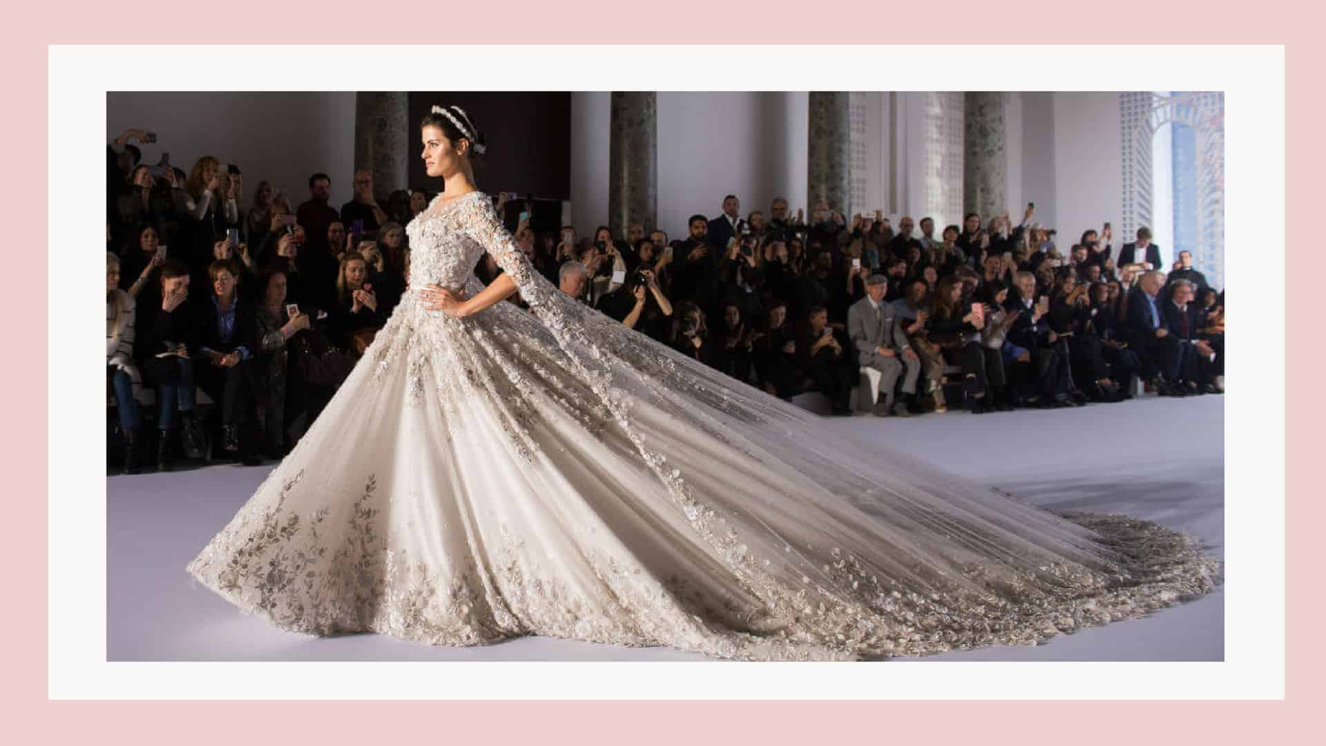 woman in wedding dress walking down runway
