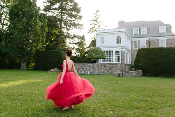 Valencienne Red Ballroom Gown on bride Grace at wedding venue