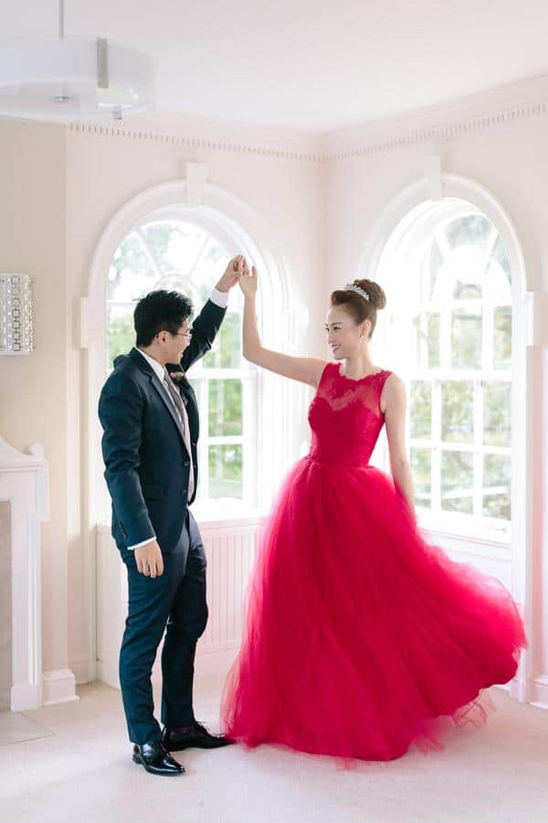 Twirling in her Valencienne red brial gown