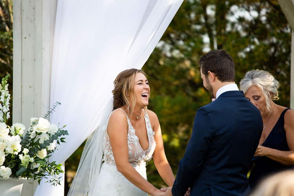 Alexandra laughing in Valencienne bespoke bridal gown