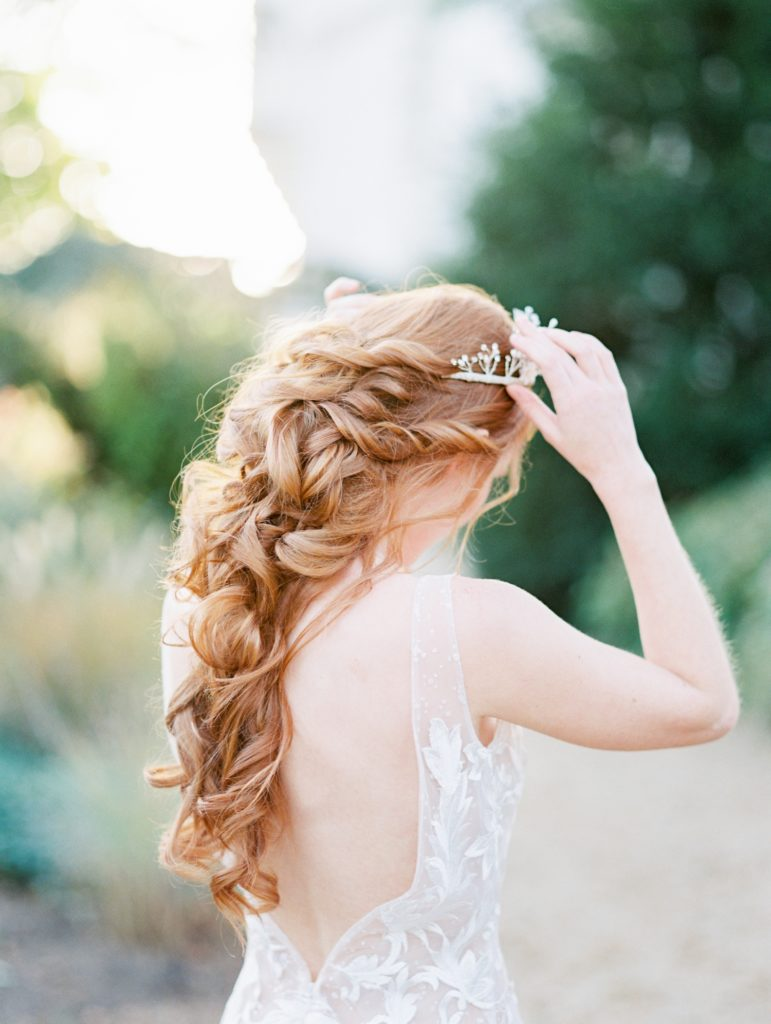 Flowing red boho braid cascading over Valencienne Bridal gown